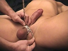 A tied up dick turns purple and painful