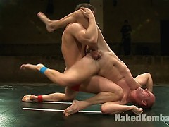 Phenix Saint pins Patrick Rouges face to the mat and fucks him all out.