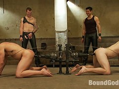 Two studly slaves gets tied up, used and abused by Christian Wilde during a live show.